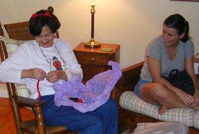 Renee opening her gag gift